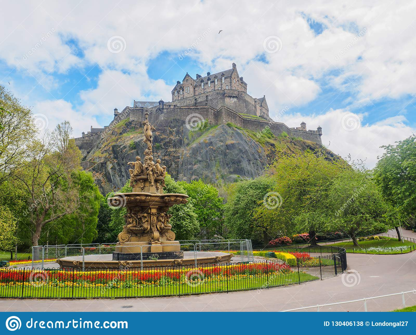 Edinburgh Castle and Ross Fountain seen from the Princes Street Gardens on a bright sunny day.
