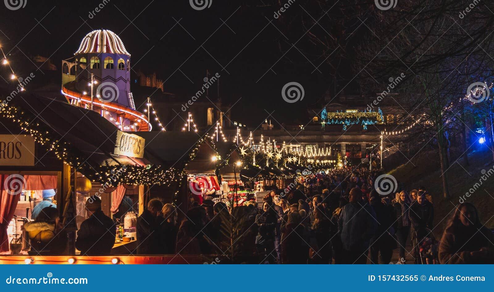 EDINBURGH, SCOTLAND DECEMBER 13, 2018: Panoramic View Of Illuminated Christmas Fair With Loads ...