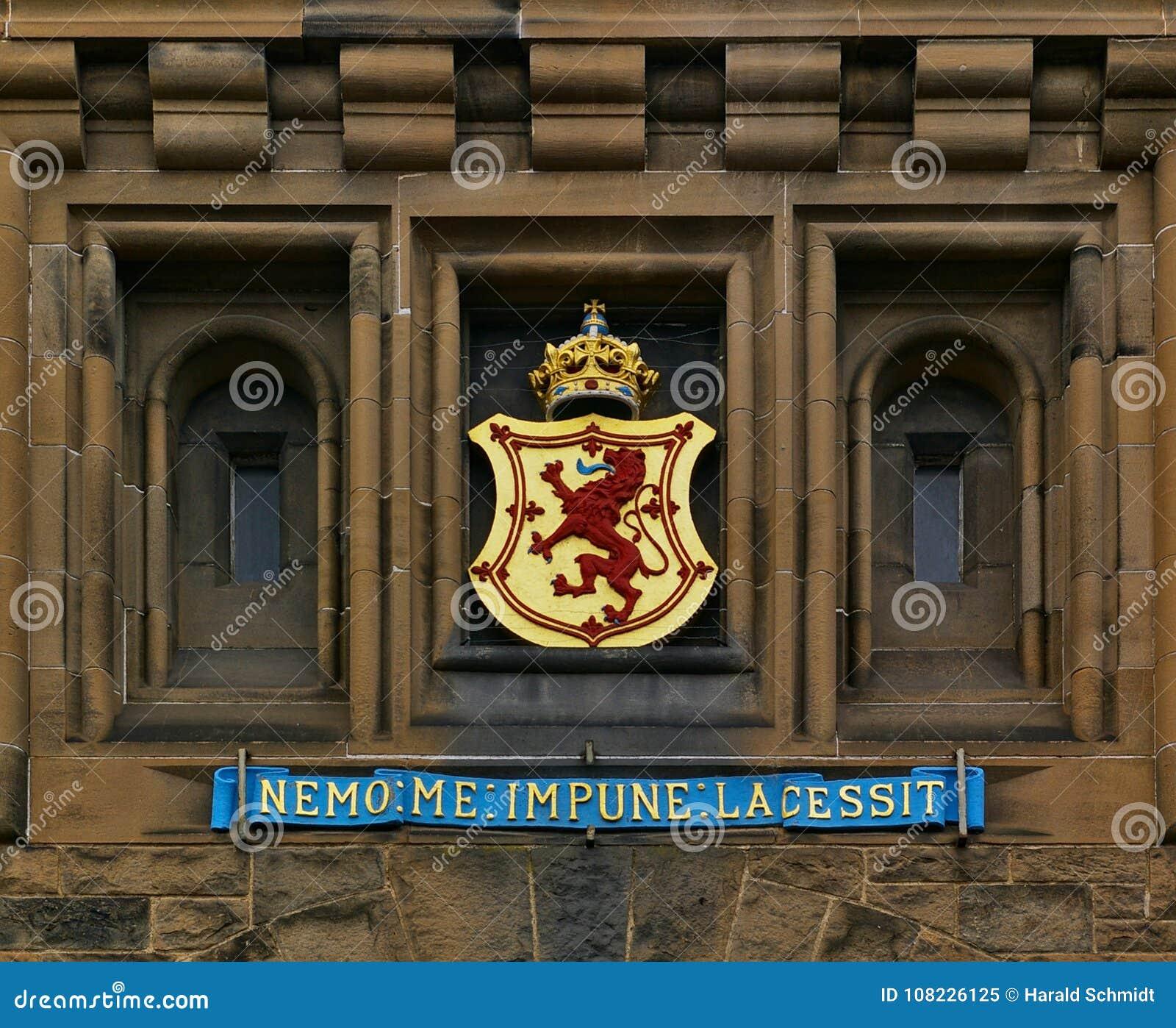 Edinburgh, Scotland - June 2nd, 2012 - Coat of arms and Scottish national motto above the main entrance of Edinburgh Castle