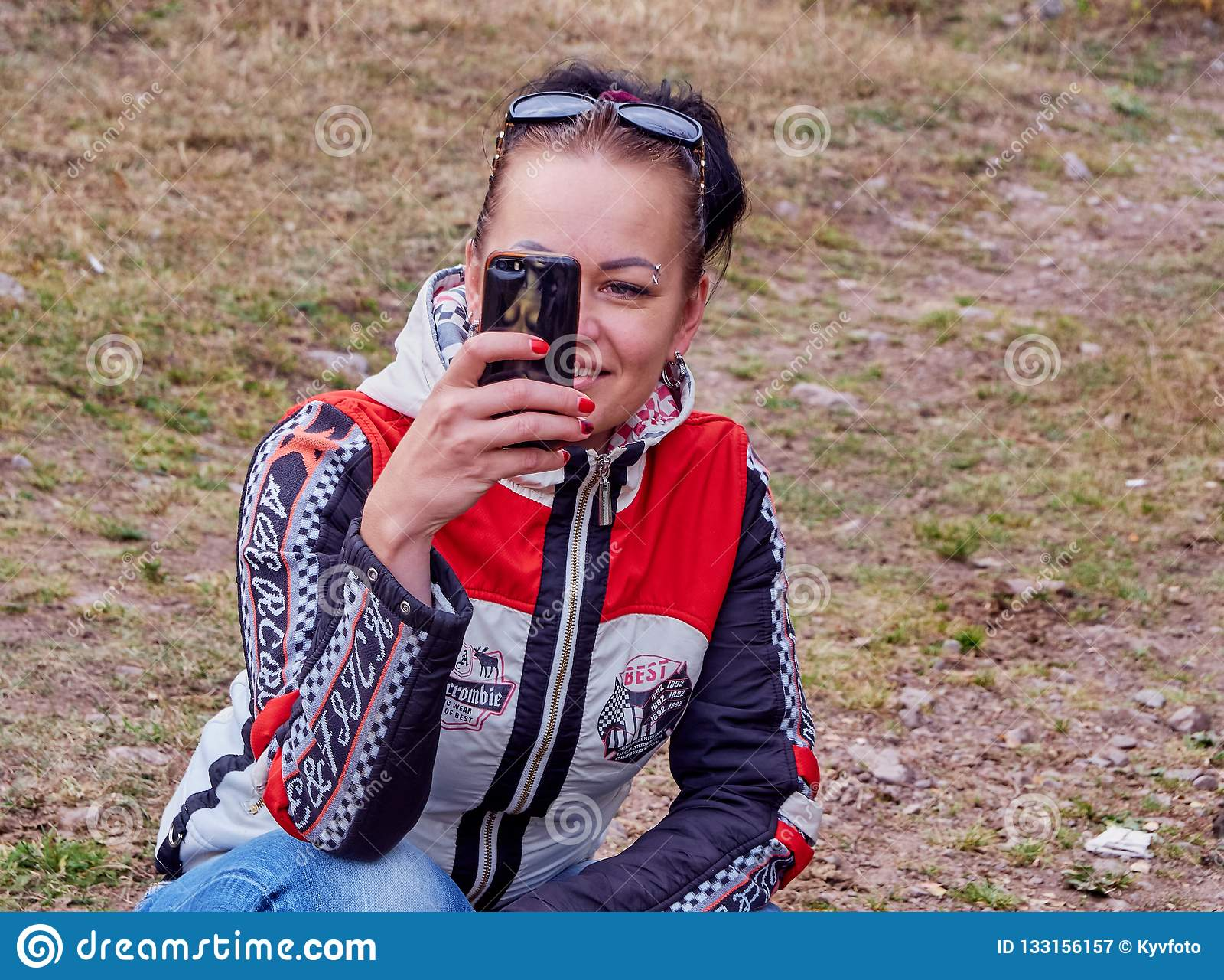 Girl takes pictures on the phone