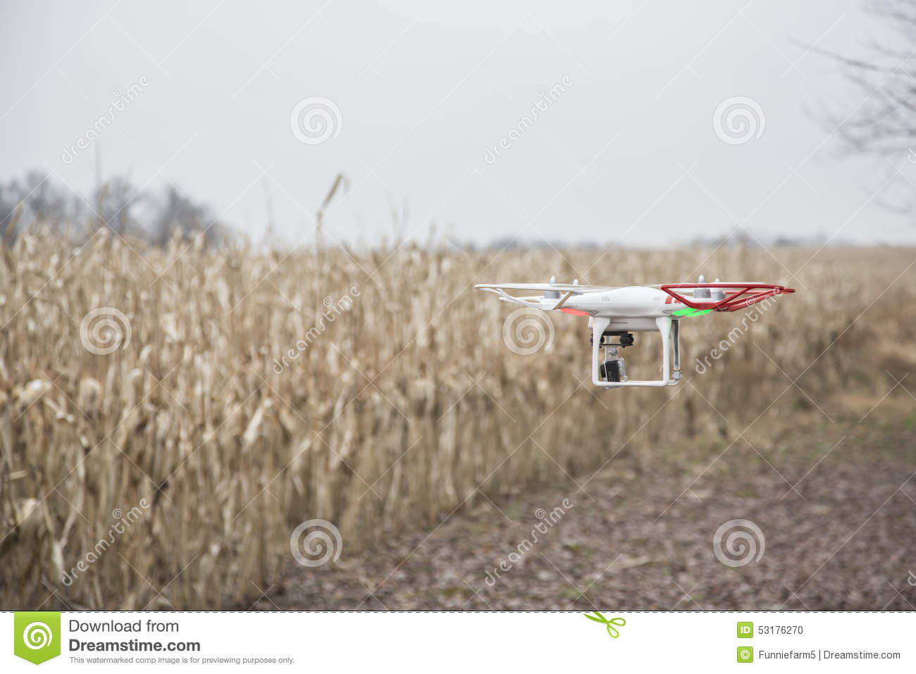 Editorial photo of a DJI Phantom drone in flight with a mounted GoPro Hero3 Black Edition