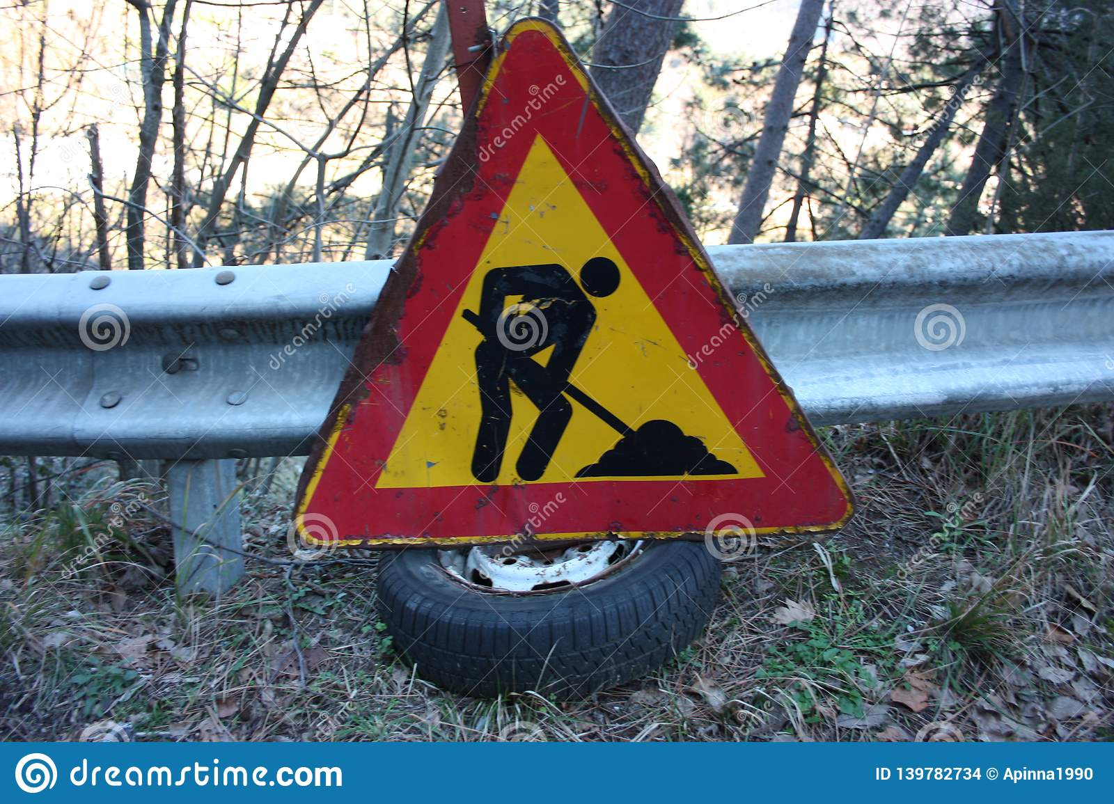 Editorial photo of a road construction site. warning signs of work in progress. cartels written in Italian. public message
