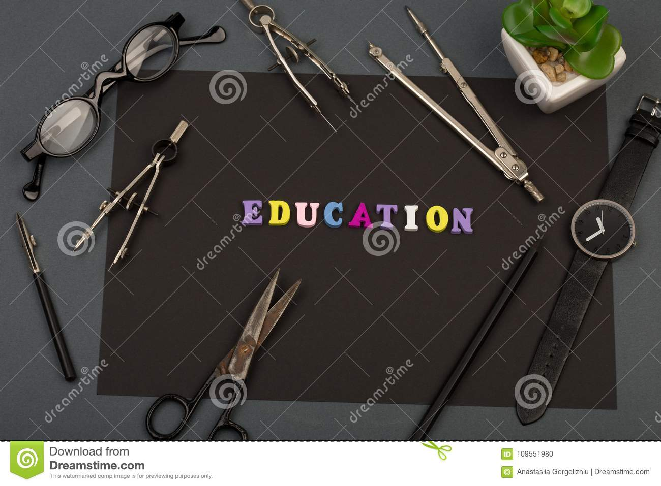 Education of architecture - black paper, text `Education` of wooden letters, engineering tools, eyeglasses, scissors