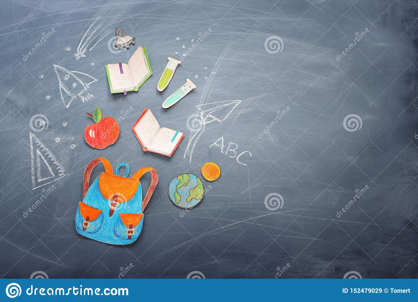 Education and back to school concept. shapes cut from paper and painted of backpack, books, chemistry flask and apple over