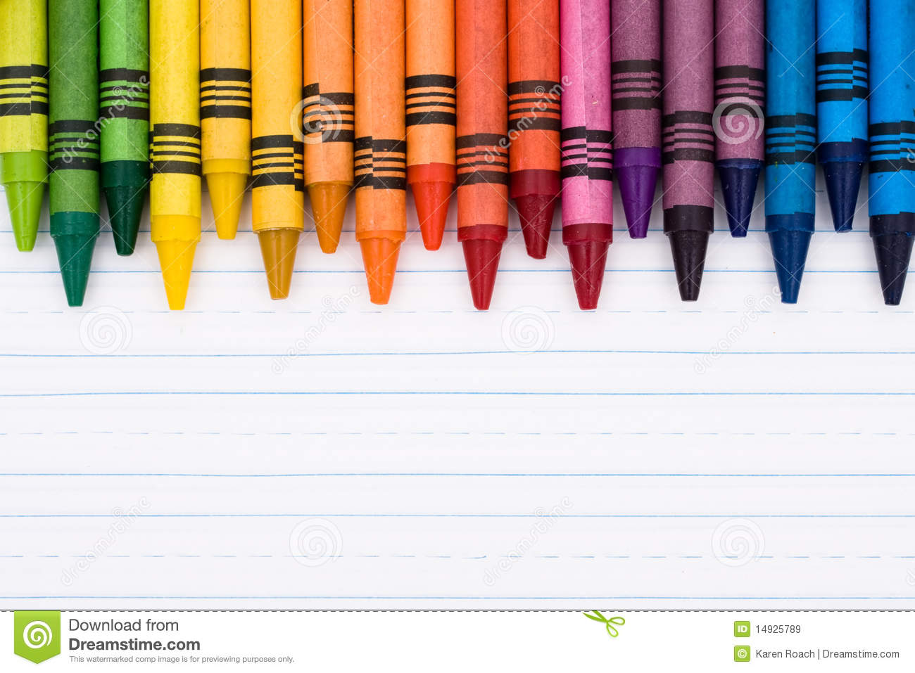 Colorful crayons on a sheet of lined paper, Education background.