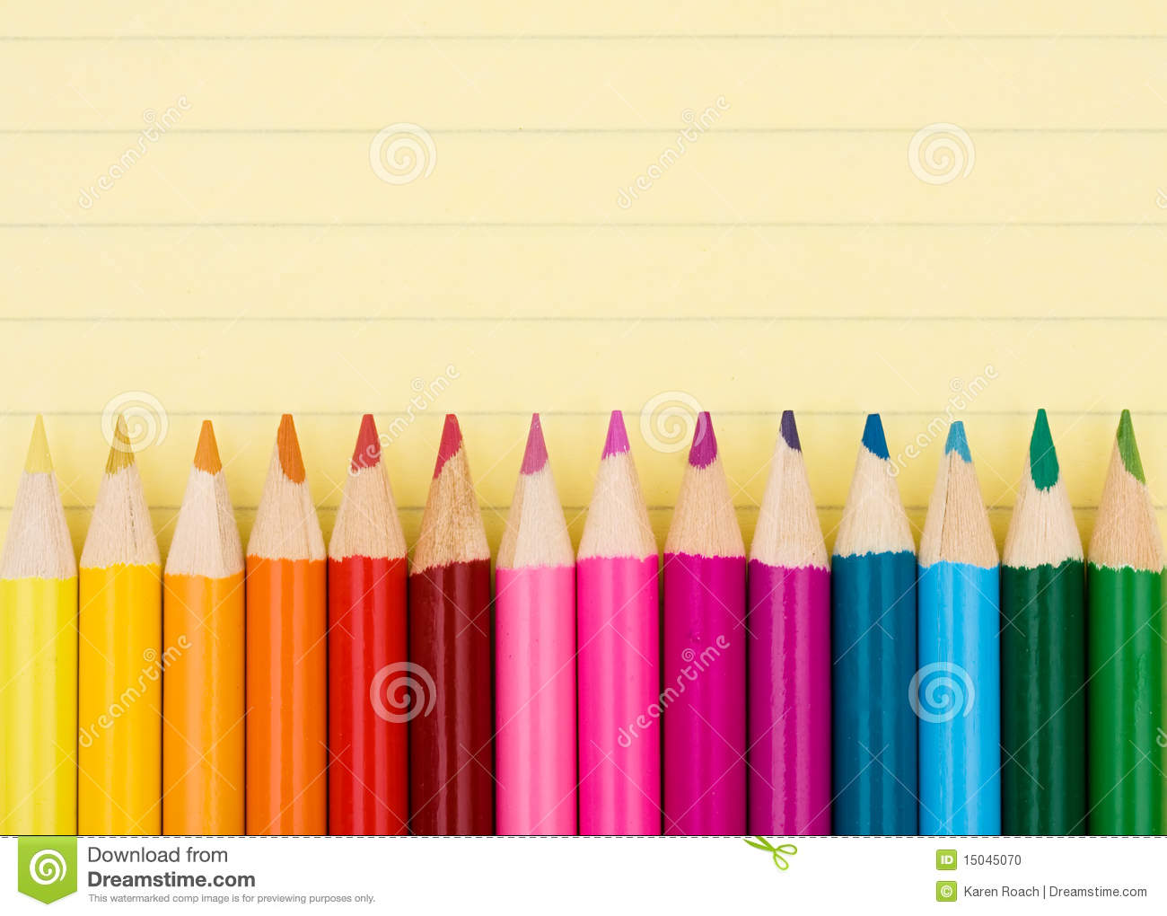 Colorful pencil crayons on a sheet of lined paper, Education ...