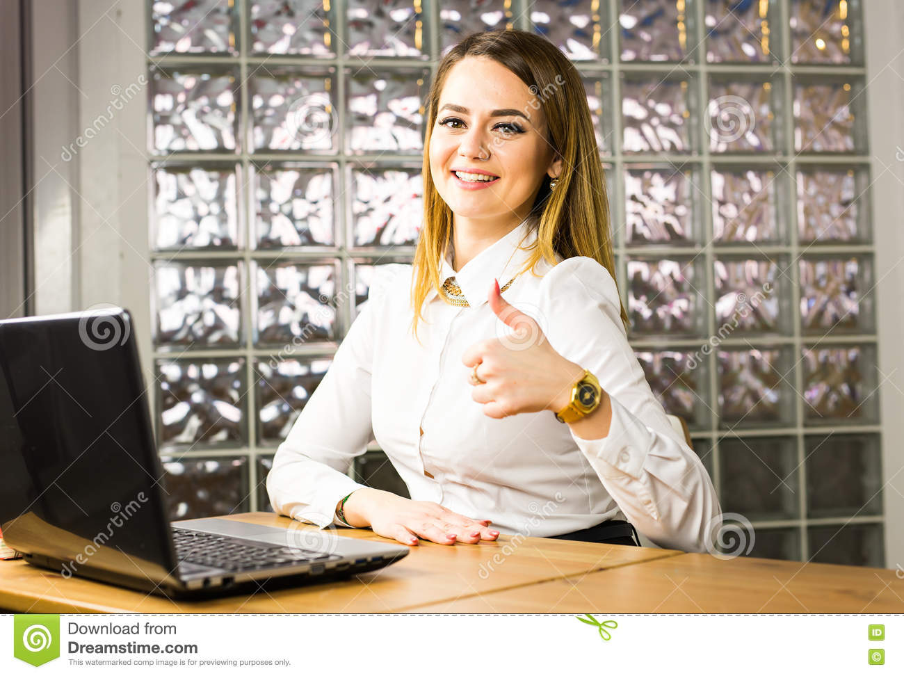 Education, business and technology concept - smiling businesswoman or student showing thumbs up with laptop computer in