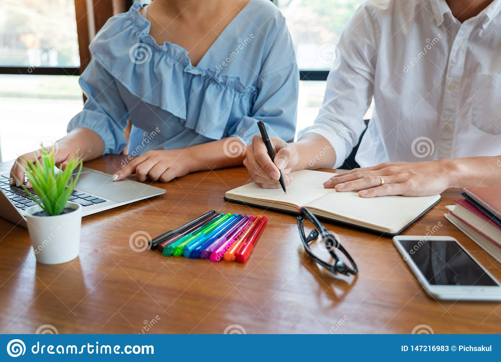 education and school concept, students campus or classmates learning tutoring catching up friend for a test or an exam in