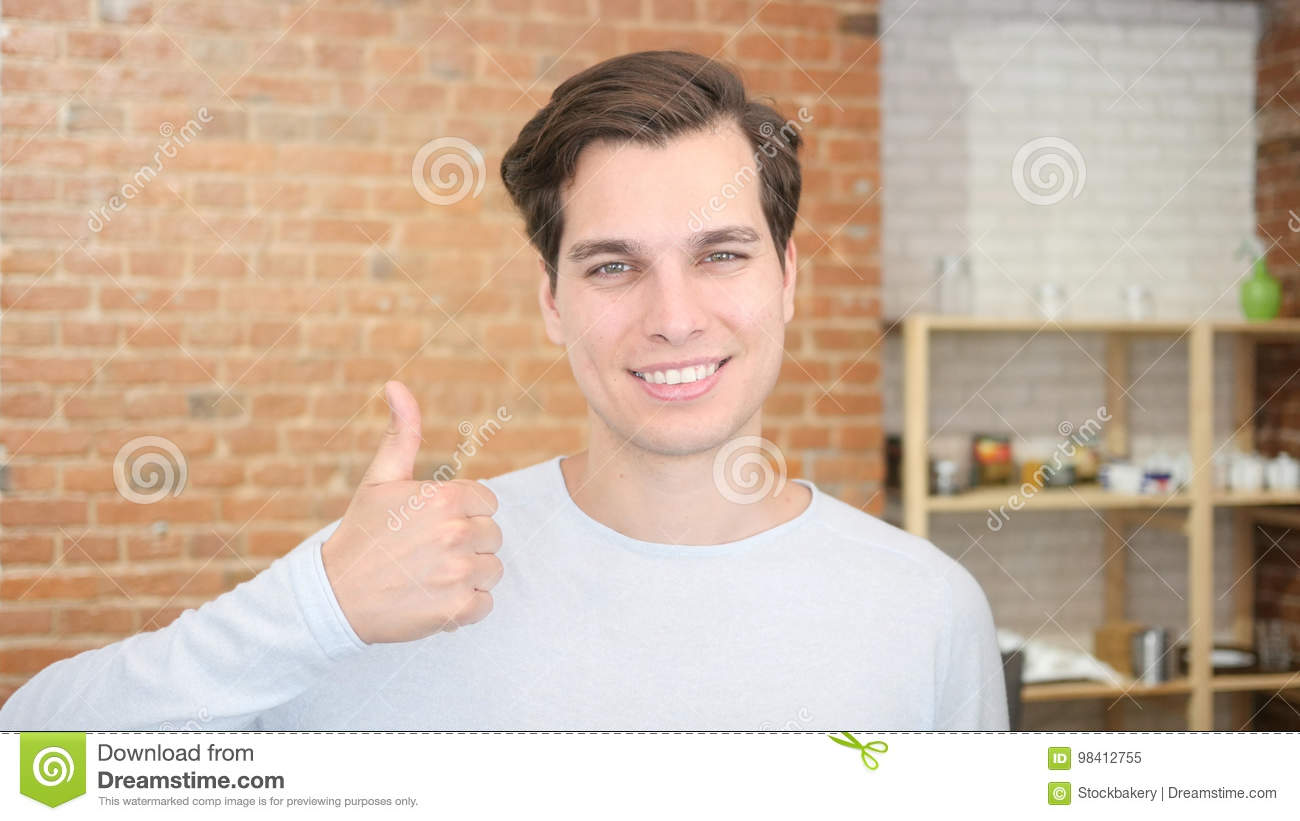 education and school - happy student showing thumbs up