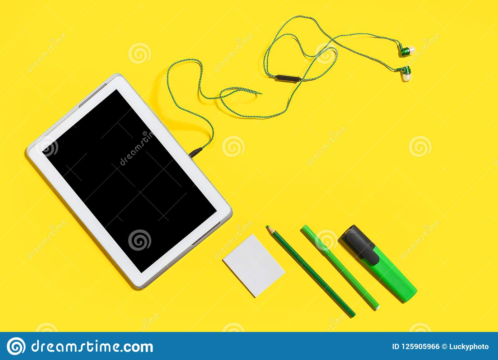 Educational accessories on a yellow surface