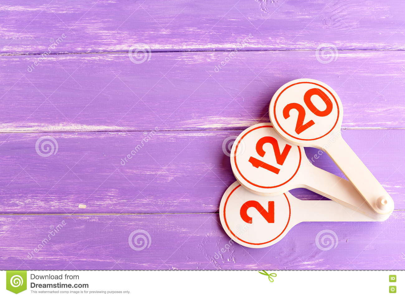 Educational toy to teach children numbers. Learning toy for kids on lilac wooden background with empty space for text