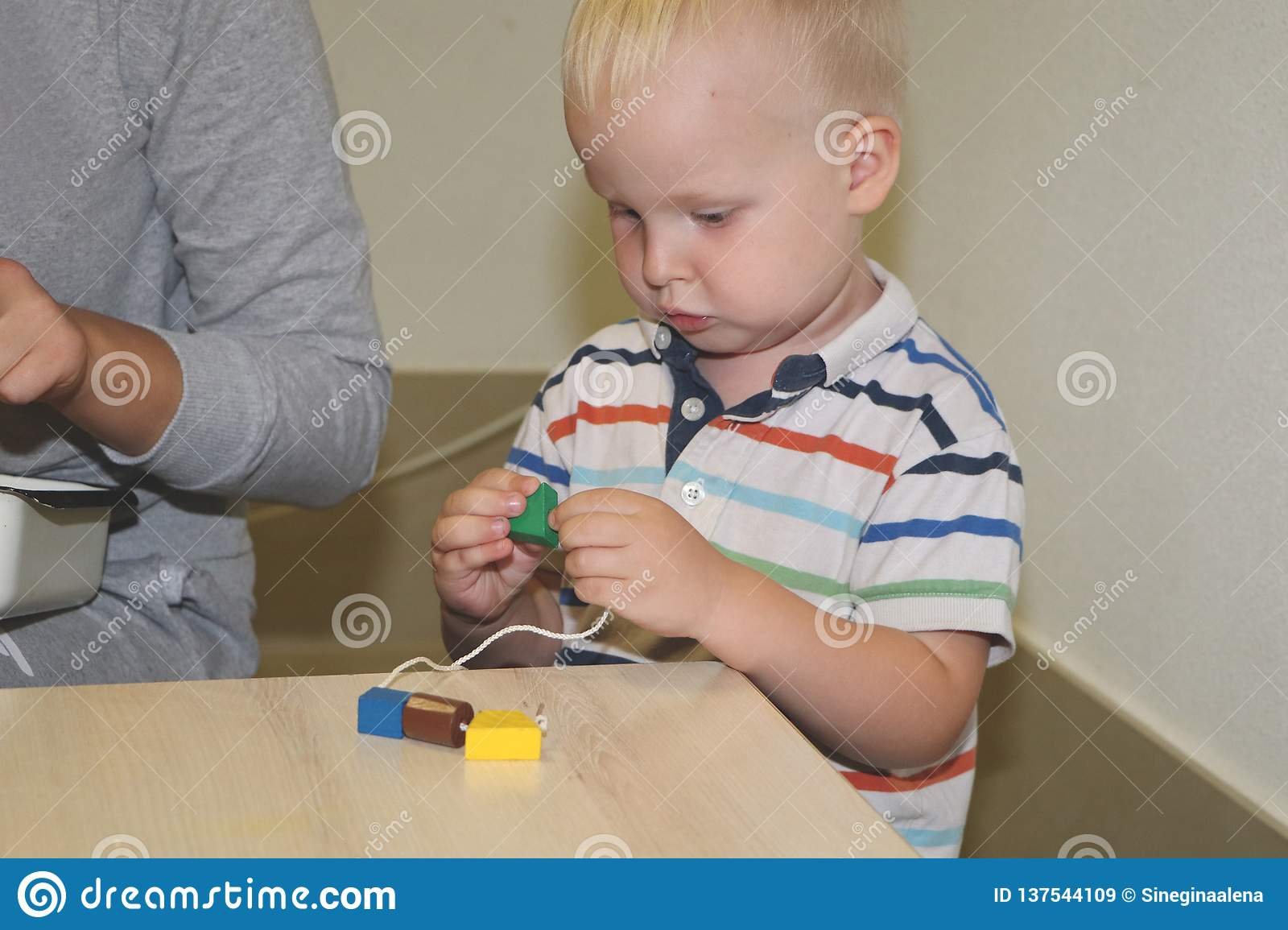 The educator deals with the child in the kindergarten. Creativity and development of the child