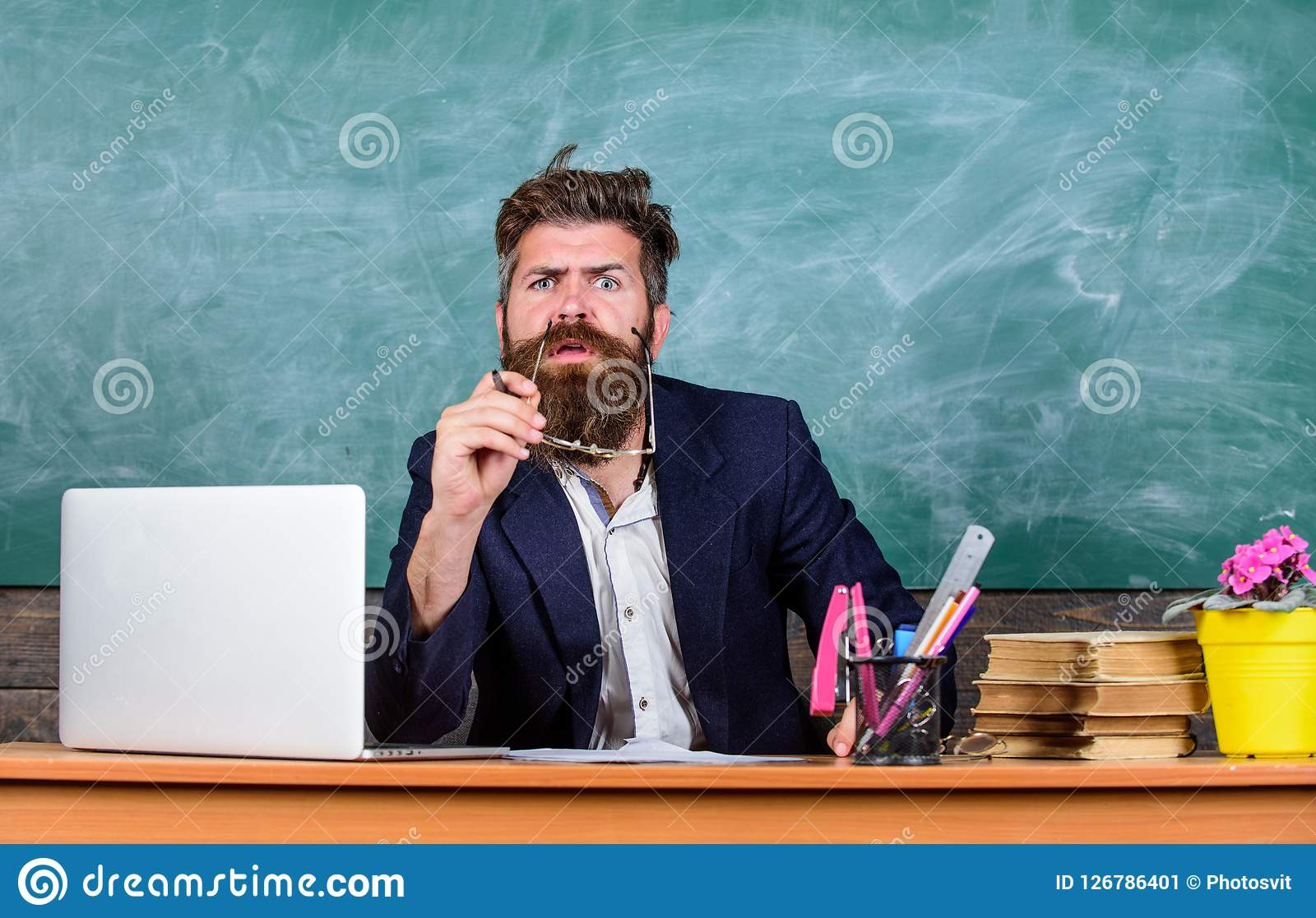 Educator finished explanation, asking is all clear. School teacher prepare ask questions. Teacher bearded hipster with