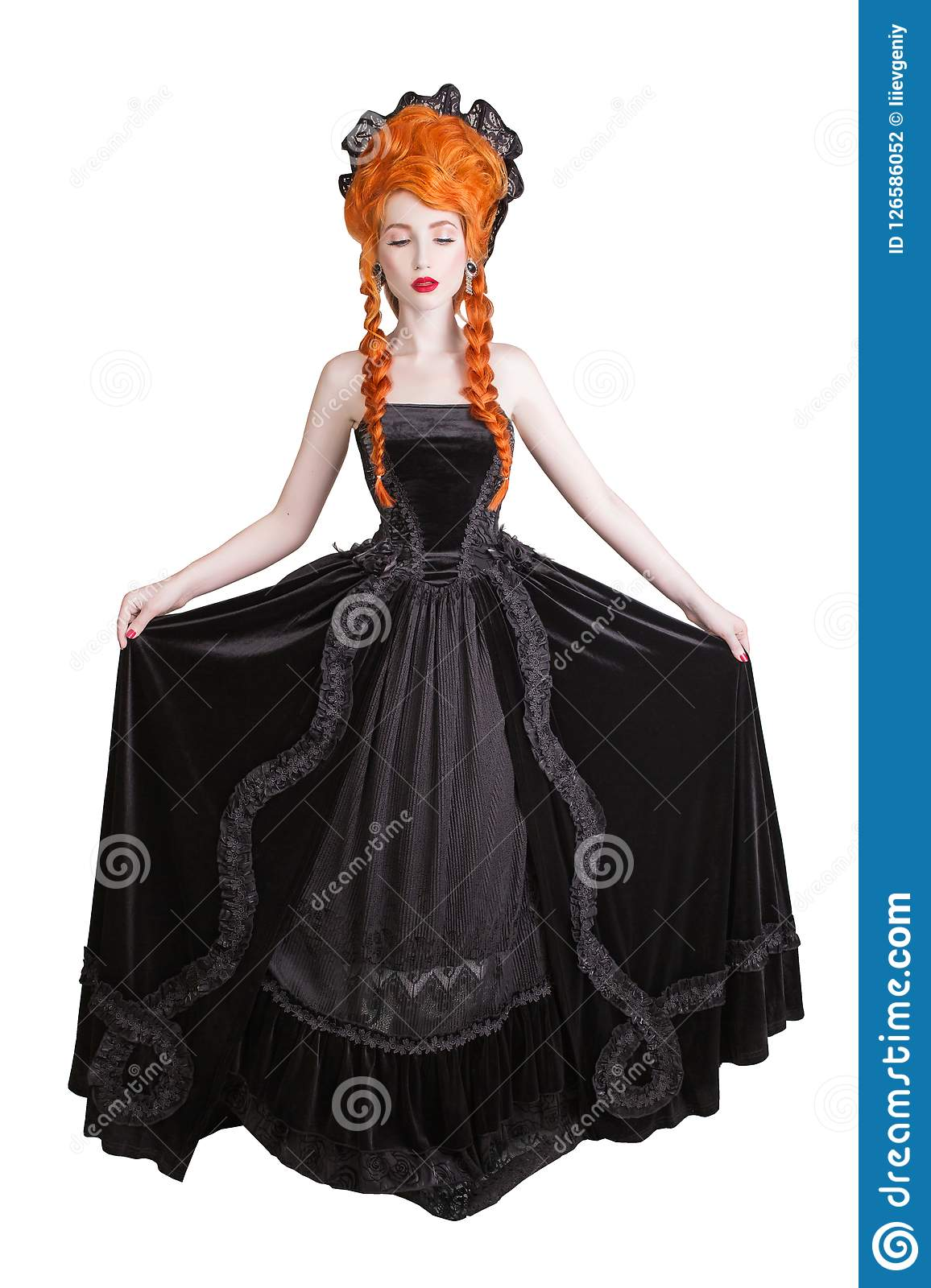 Edwardian redhead queen with halloween hairstyle isolated on white background. Fairytale queen in black gothic dress.