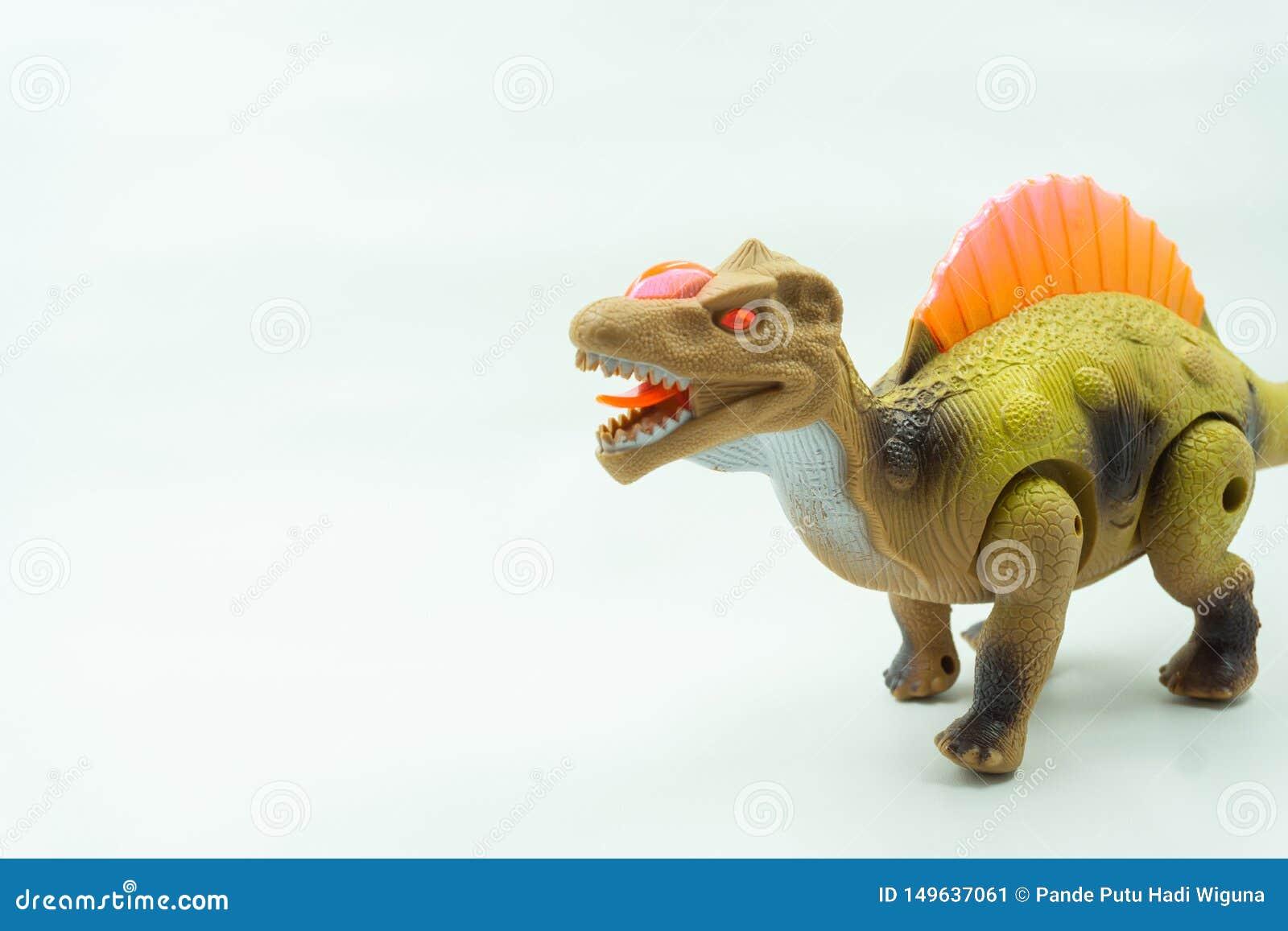 Een dinosaurussenstuk speelgoed op witte achtergrond Het speelgoed van Plasticedinosaurussen op witte achtergrond, idee voor jong