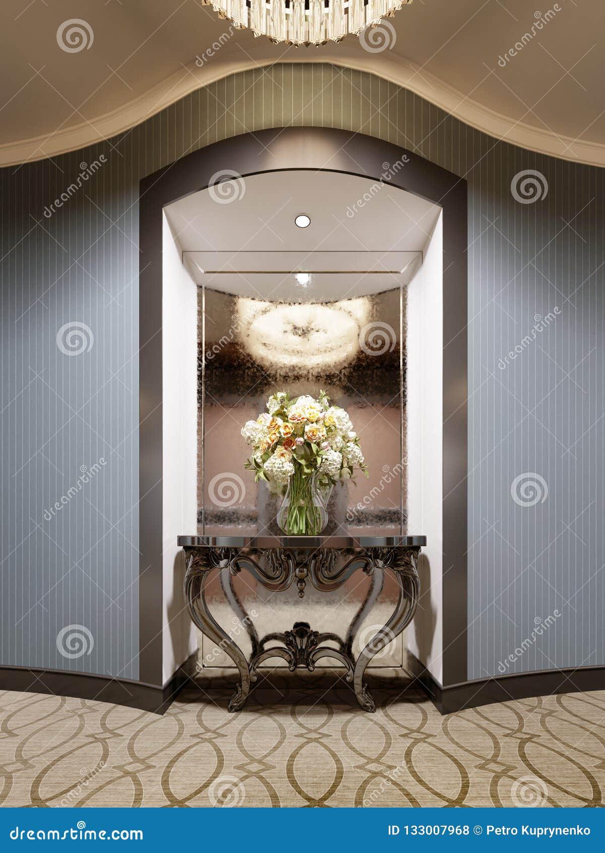 Een gebied in de muur van de hotelgang met een spiegel en een klassieke console met bloemen en verlichting