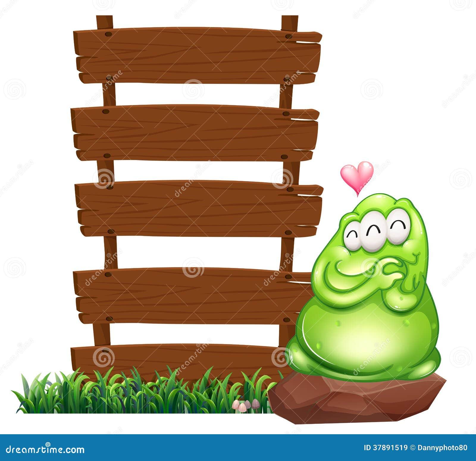 Een groen monster naast de lege houten raad