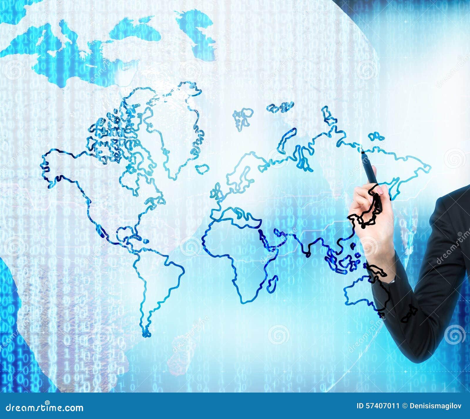 Een hand trekt het digitale bedrijfsleven De wereldkaart wordt getrokken over de digitale bol