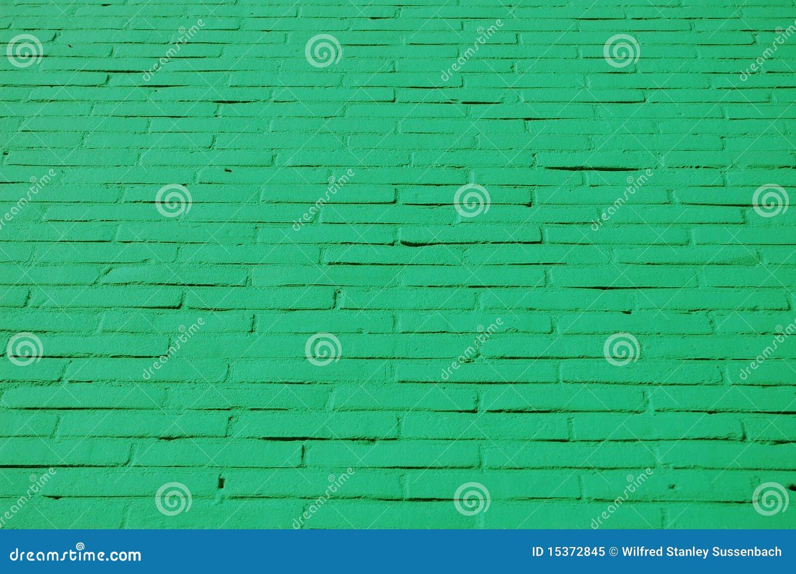 Een muur met groene bakstenen royalty vrije stock foto ...