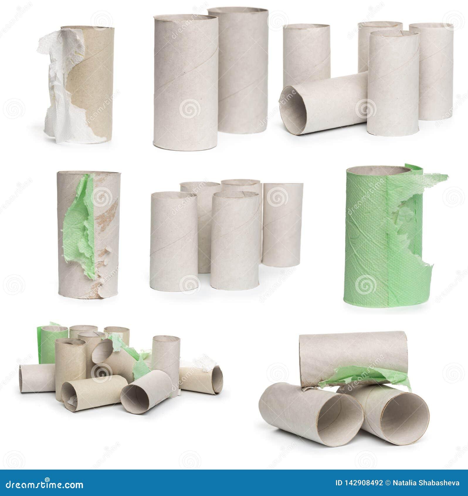 Een selectie van de buizen van het kartontoiletpapier in diverse die regelingen op een witte achtergrond worden geïsoleerd