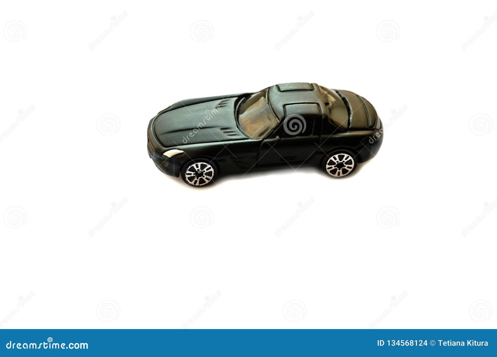Een stuk speelgoed auto op een witte achtergrond