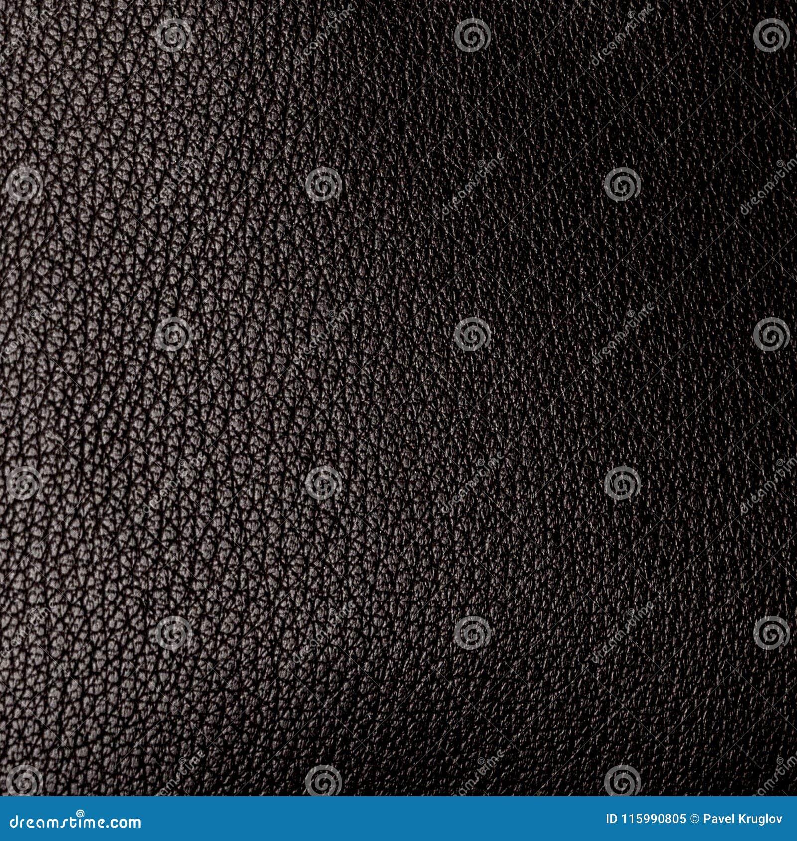 Een stuk van zwarte kunstledertextuur met hoogtepunt en g