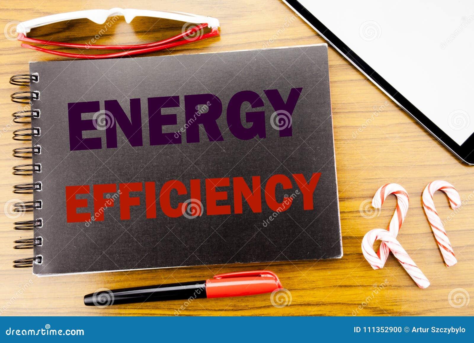 Effektivitet för energi för handskriftmeddelandetext Affärsidé för elektricitetsekologi som är skriftlig på notepadanteckningsbok