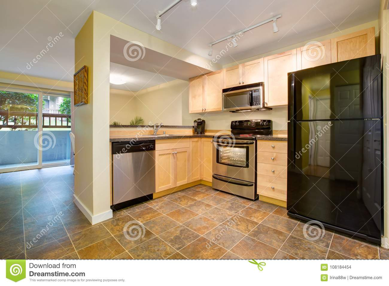 Efficient, Compact Kitchen Design With Honey Stained Kitchen ...