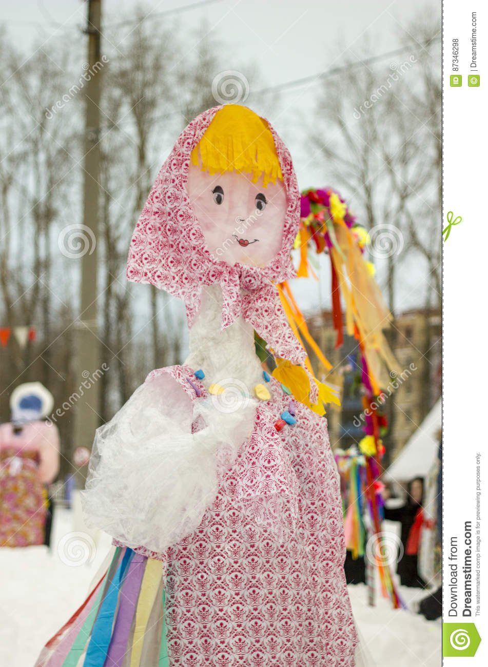 The Effigy Of Maslenitsa. Bright doll in Russian national clothes