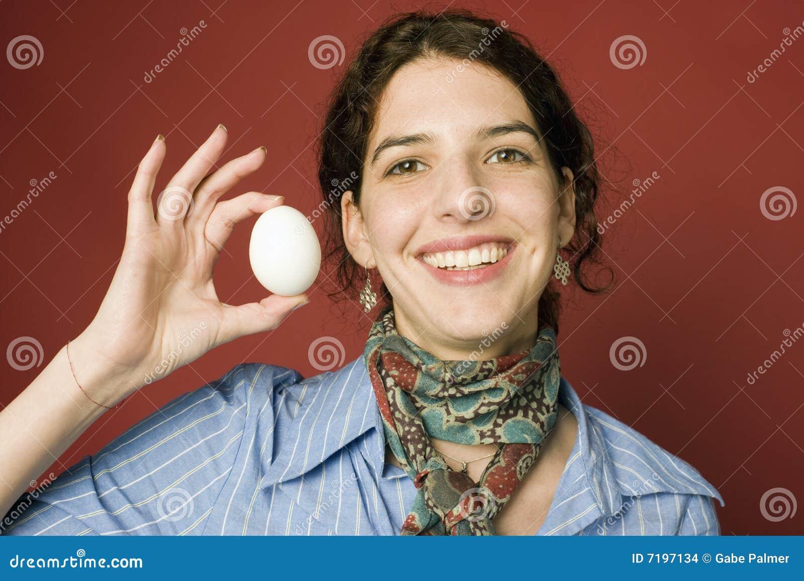 Egg holding woman