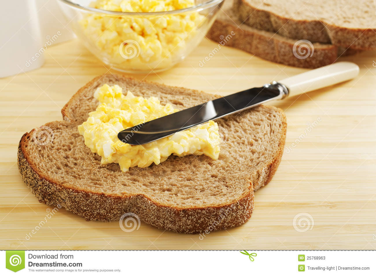 Egg Mayonnaise Being Spread On Bread Stock Photos Image