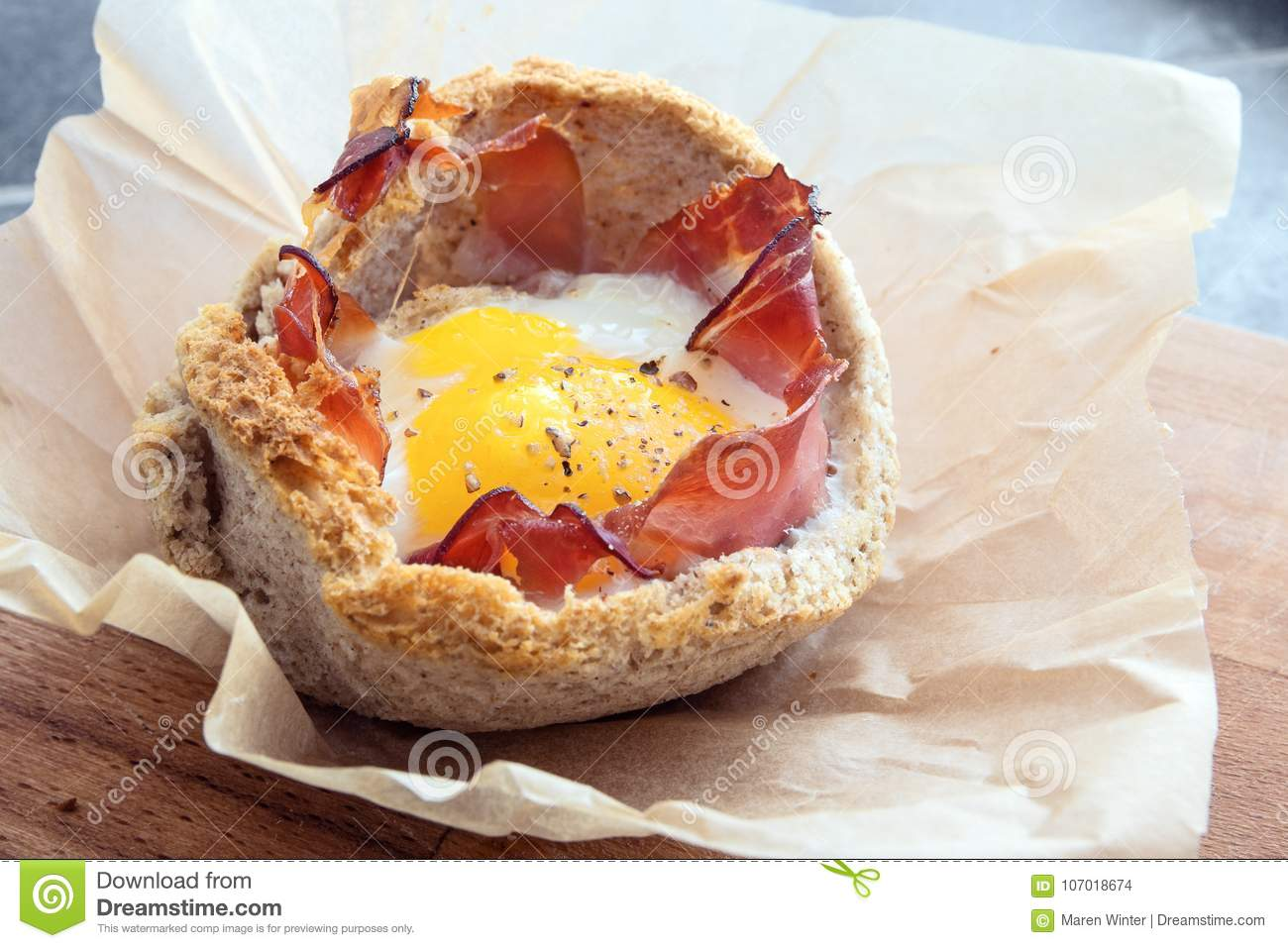 Egg Muffin With Bacon And Toasted Bread On Baking Paper Creative Breakfast Copy Space Stock Photo Image Of Baked Morning 107018674