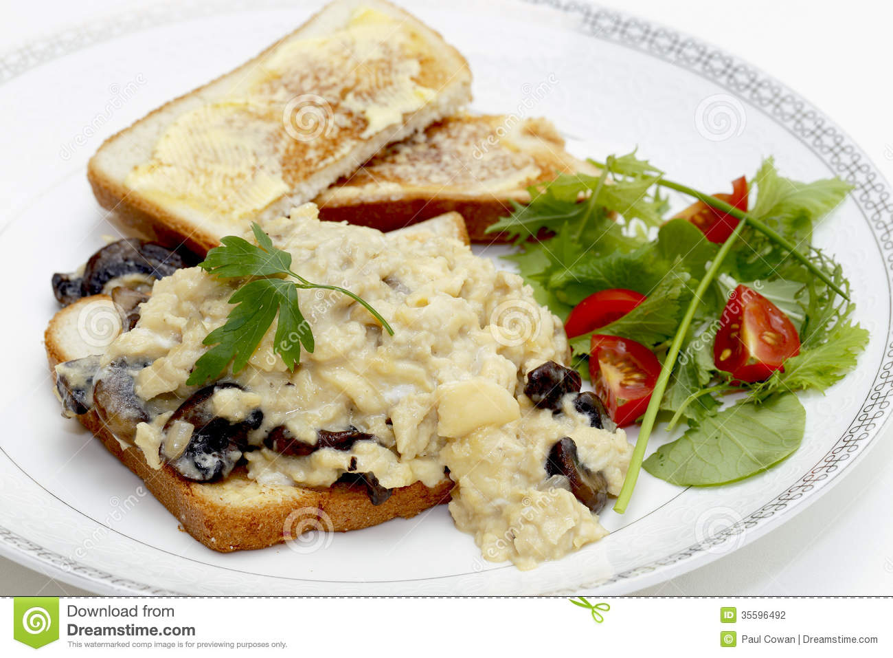 ... eggs on toast made with fried mushrooms and shallots served with a