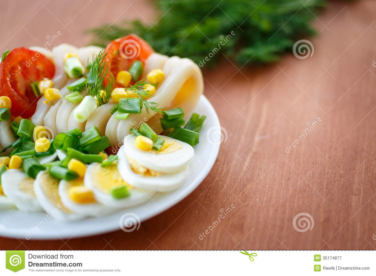 Egg salad and squid with green onions.