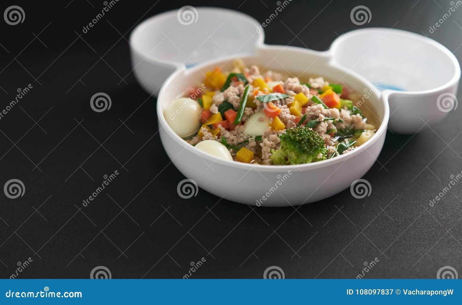 Egg vegetable and pork soup on black background