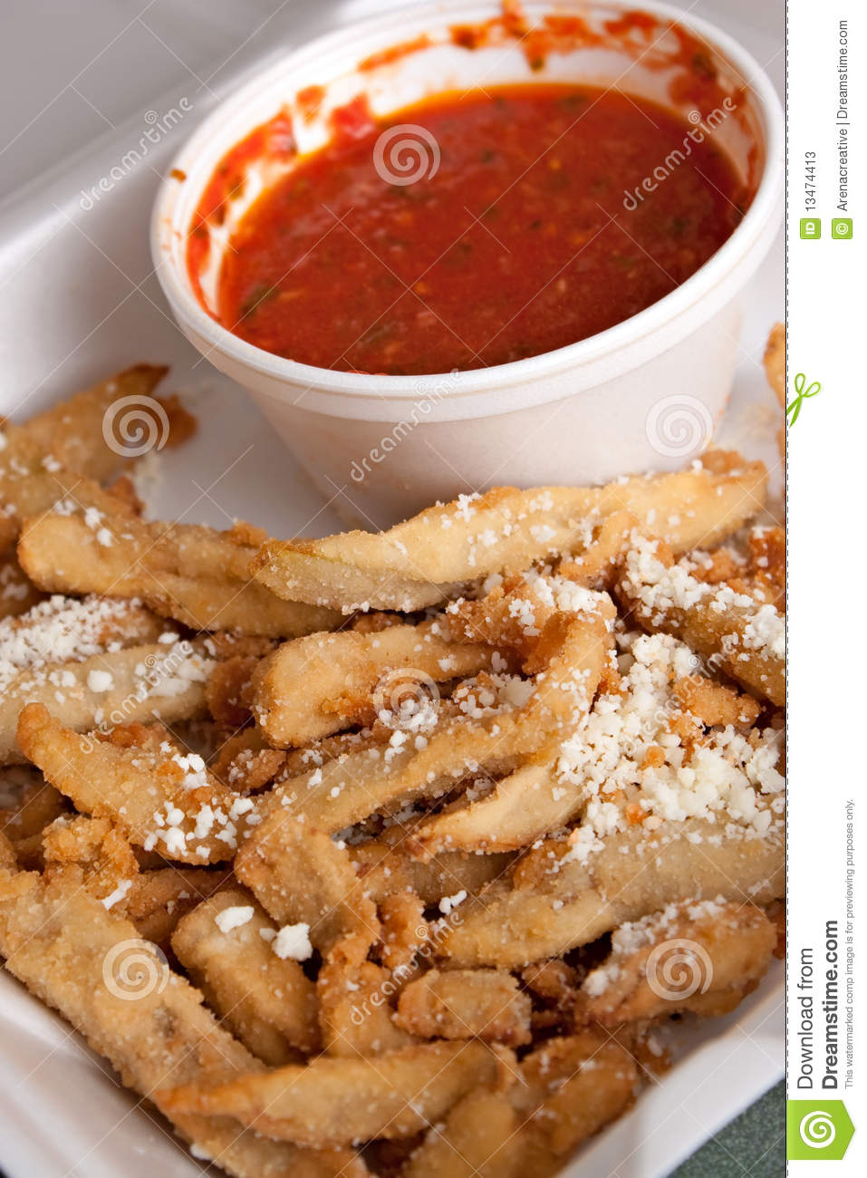 Fried eggplant with tomato marinara dipping sauce topped with parmesan ...