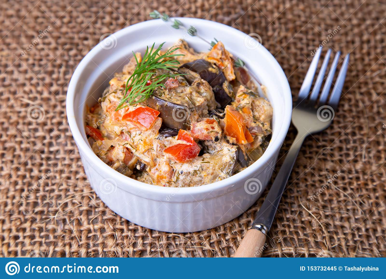 Eggplants with tomatoes, bulgarian red sweet pepper, onion, dill and sour cream.