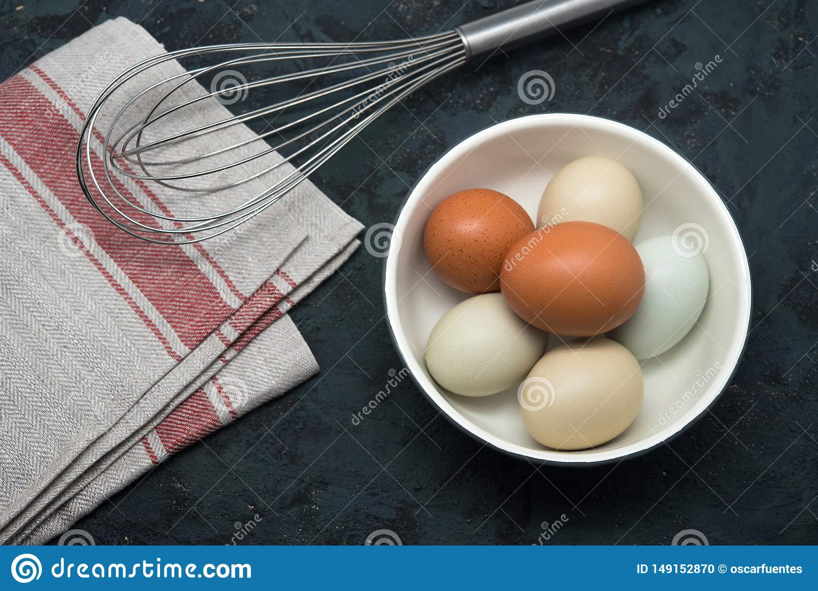 Eggs with beater on table