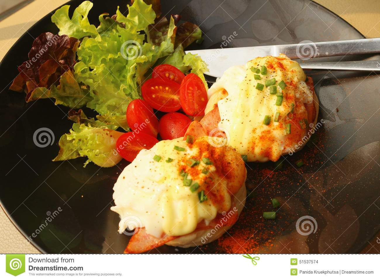 Eggs Benedict ,vegetable ,eggs On A Black Plate. Stock Photo - Image ...