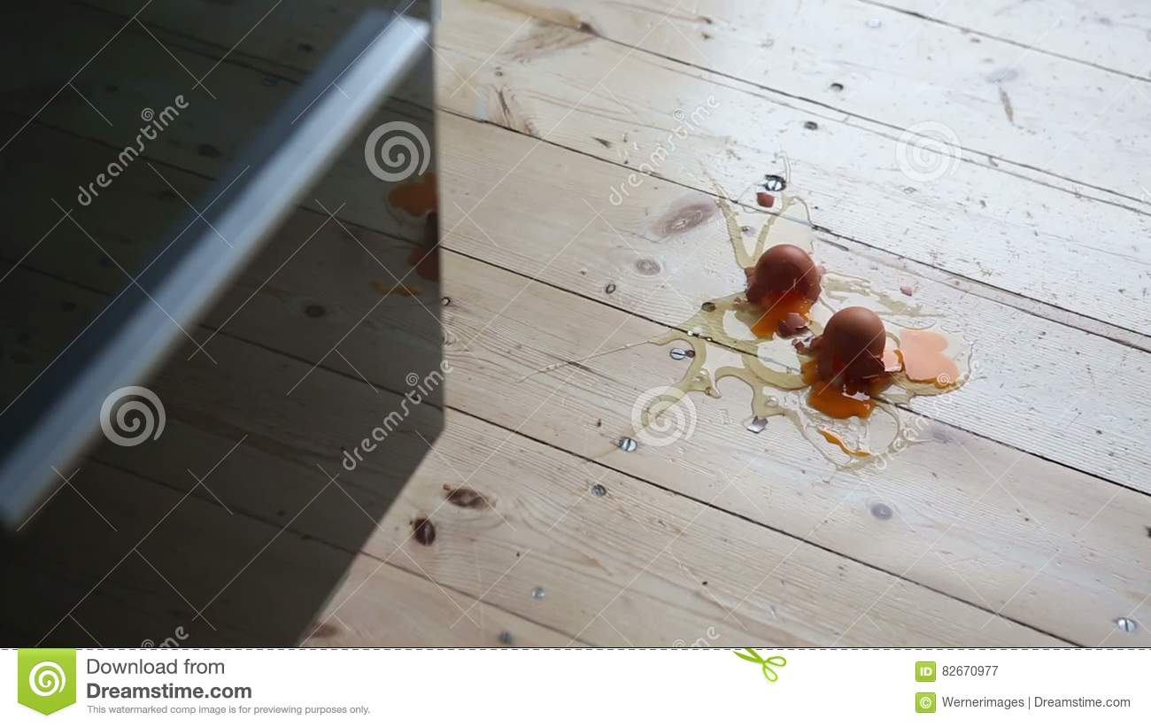 Eggs Falling On The Kitchen Floor And Making A Mess Stock Video ...