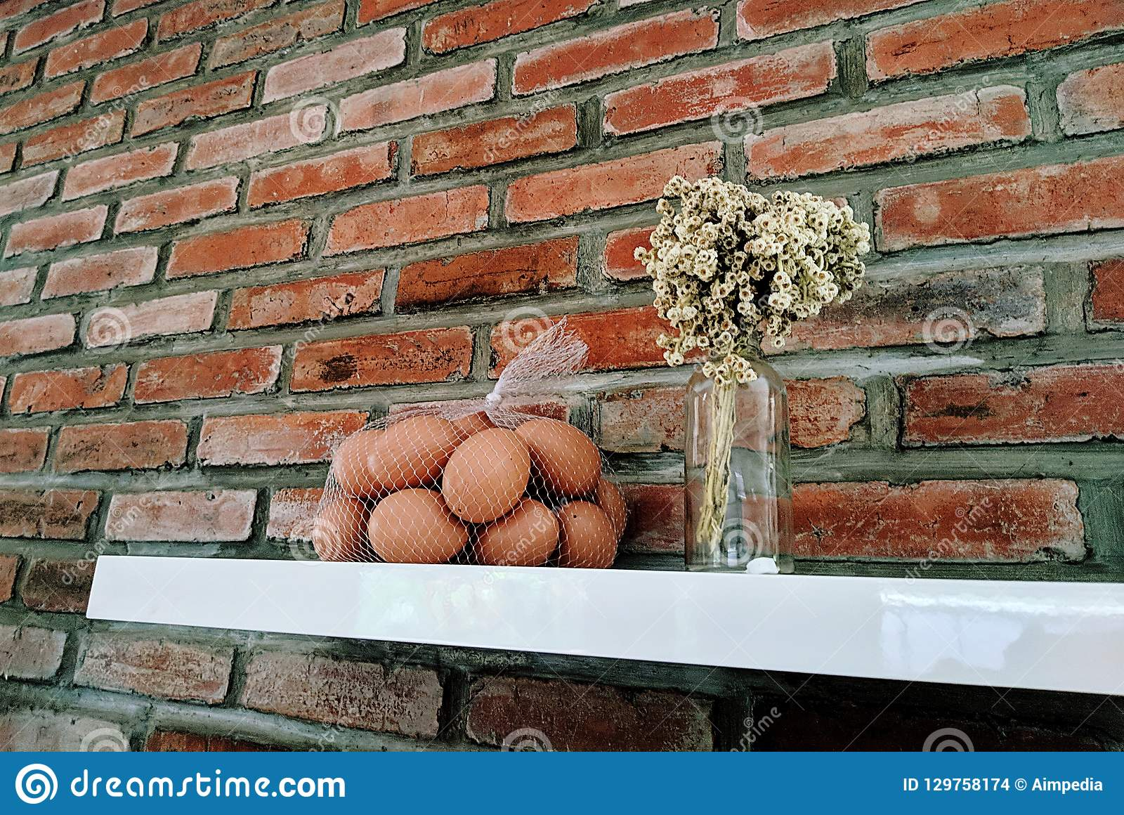 Eggs In Front Of The Red Brick Stock Photo - Image of design ...