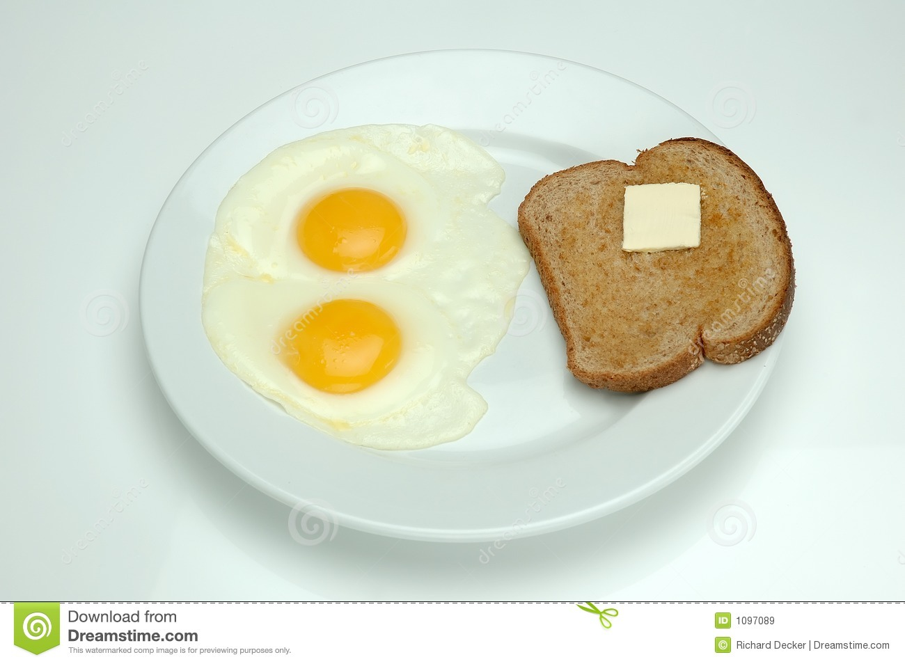 Two sunny side up eggs and toast for breakfast to start off the day.