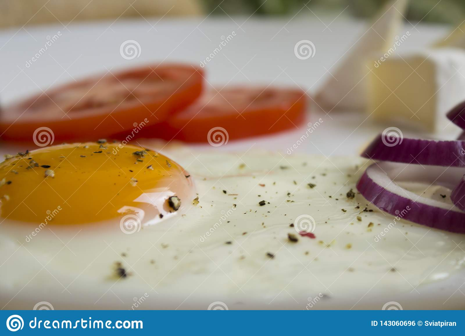 Eggs with a tomato and red onion