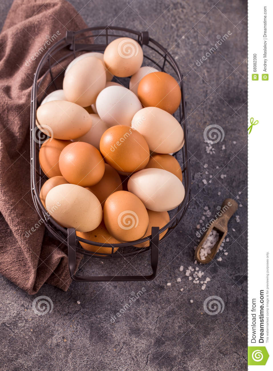 Eggs in wire basket on gray background above view
