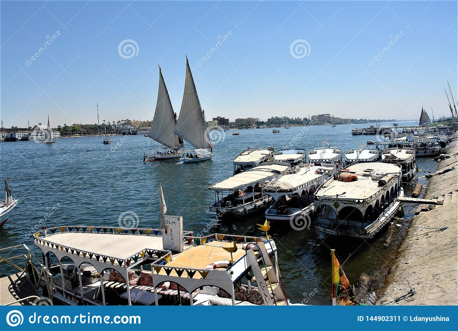 Egypt, Luxor. Cruise boats at the pier. Tourist yachts ply the river.