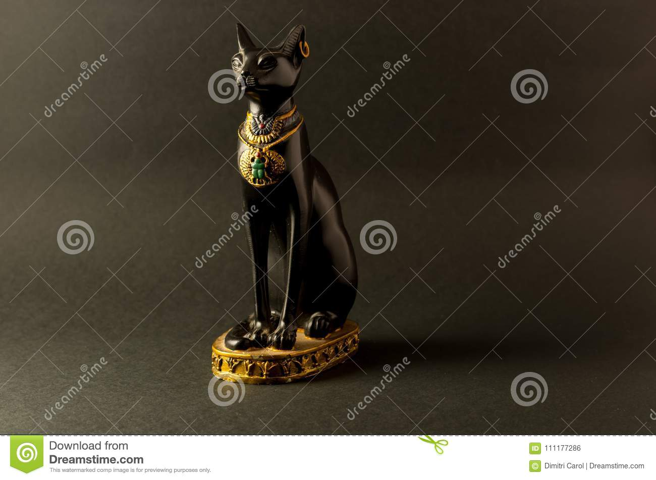 Egyptian black bastet cat figurine on black background