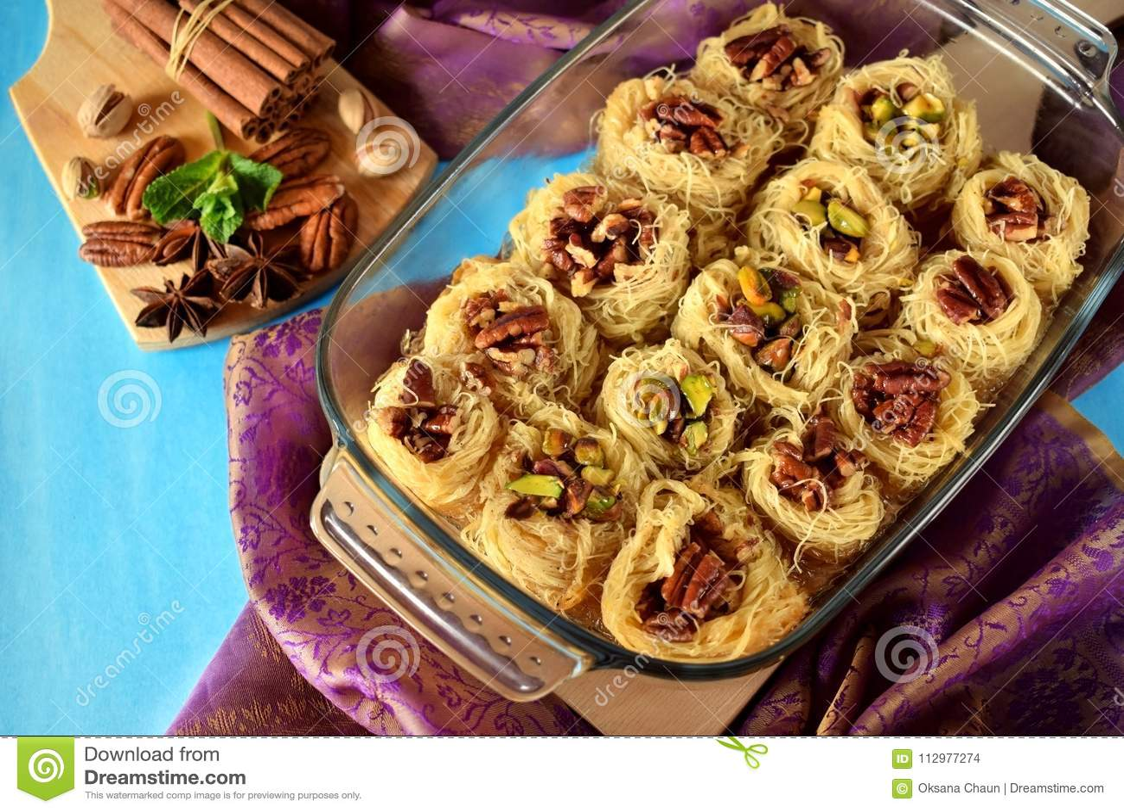 Egyptian dessert Kunafa made of kataifi dough with pistachio and pecan nuts