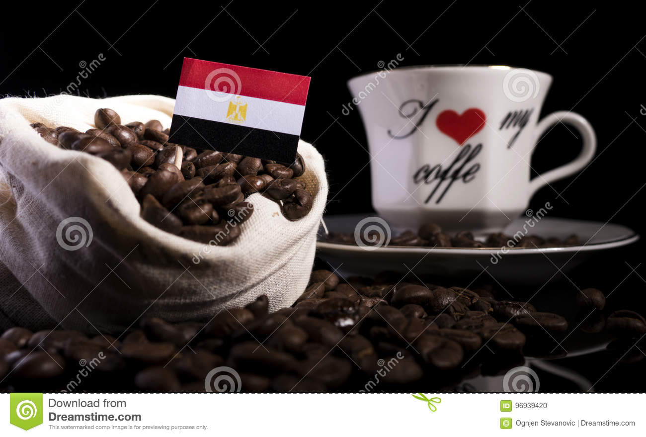 Egyptian flag in a bag with coffee beans isolated on black