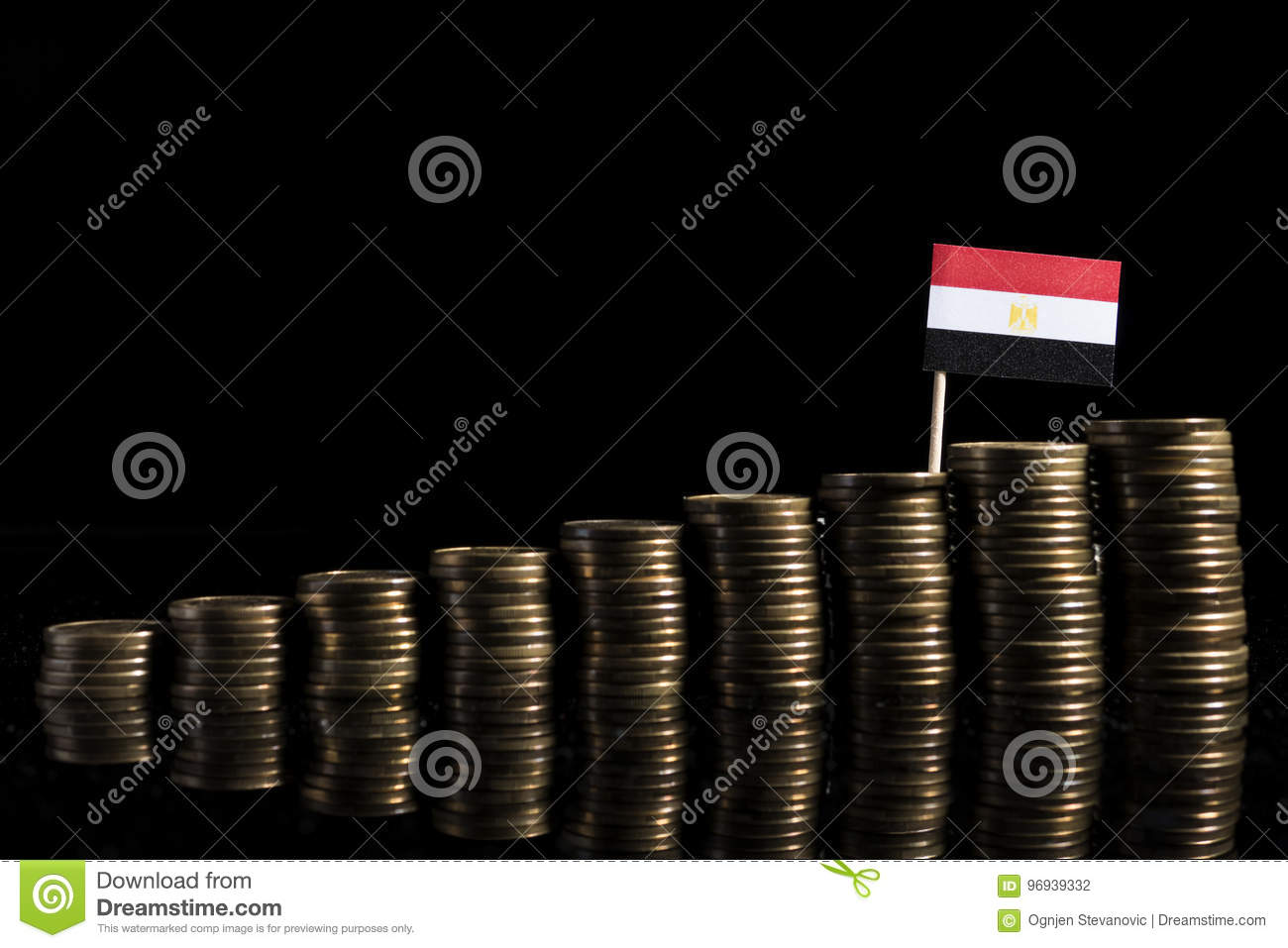 Egyptian flag with lot of coins isolated on black
