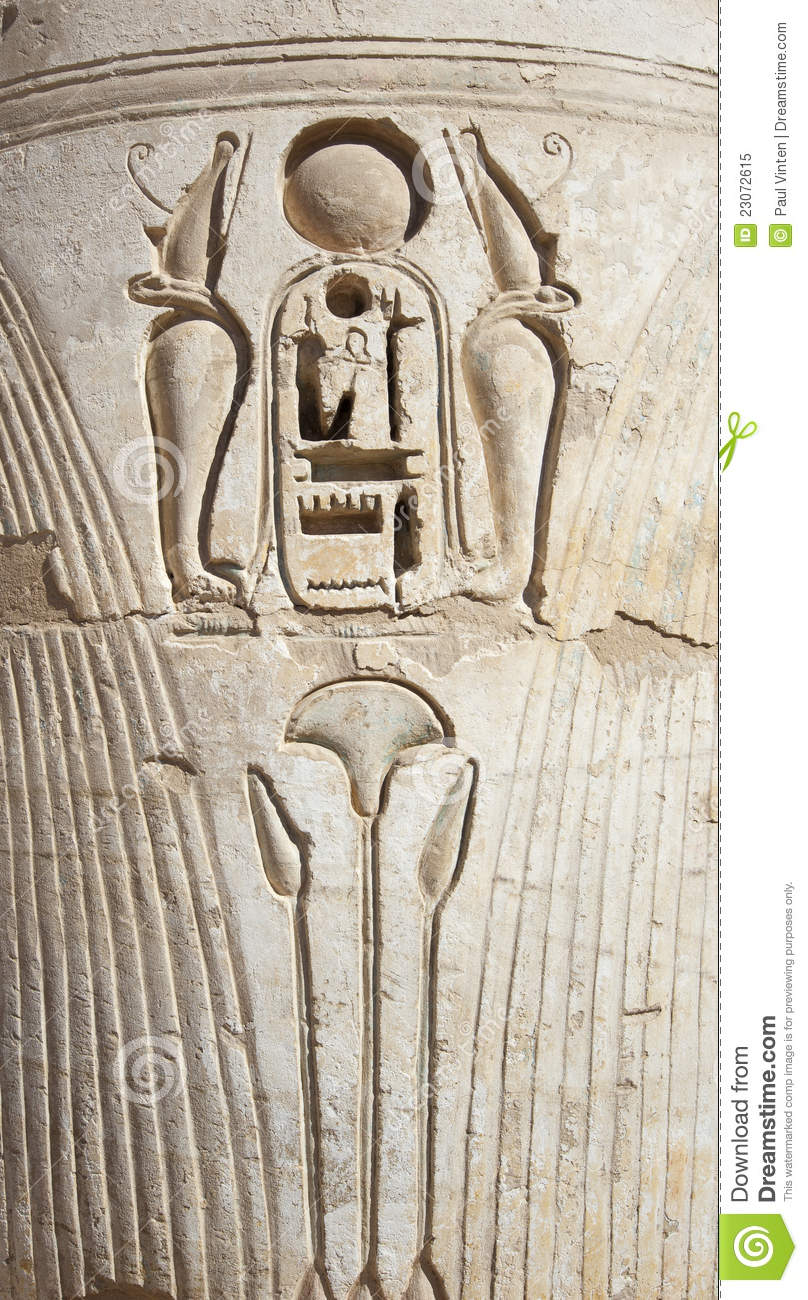 Egyptian hieroglyphic carvings on a temple wall stock